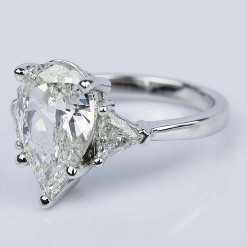 Three Stone Trillion Engagement Ring With Pear Diamond Center