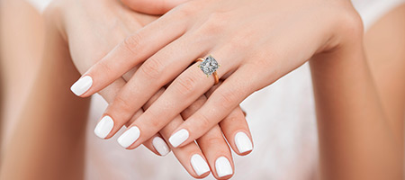 woman wearing a radiant cut diamond ring